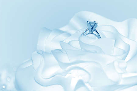 Wedding ring tinted icy blue. Stock Photo
