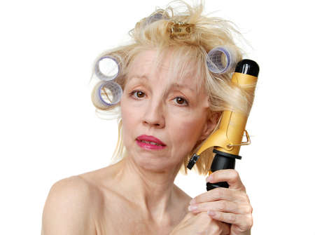 bad hair day: Curler Woman - A blonde woman with lavender curlers in her hair.  Bad hair day. Stock Photo