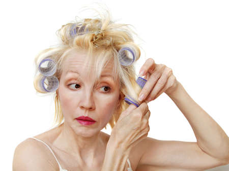 bad hair day: A blonde woman with lavender curlers in her hair.  Bad hair day.