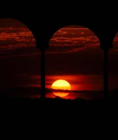 russet: A brilliant russet sunset is the backdrop for a silhouette of a gazebo.