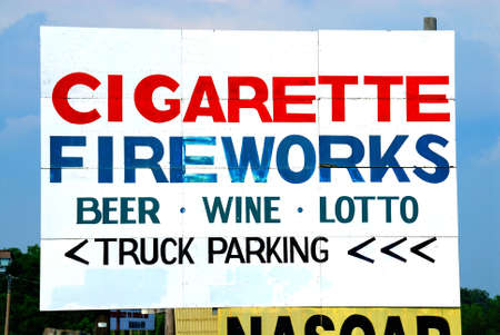 forewarning: Billboard on the side of the road advertising fireworks, cigarettes, beer, wine and truck parking.