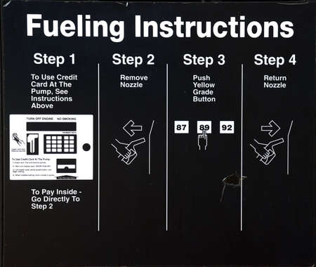 forewarning: Fueling Instructions at a self-service gas pump.  Stock Photo