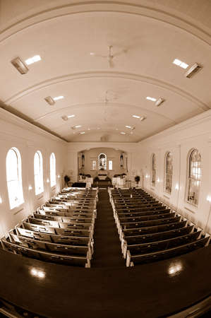 Fisheye sepia image of the interior of an empty church.