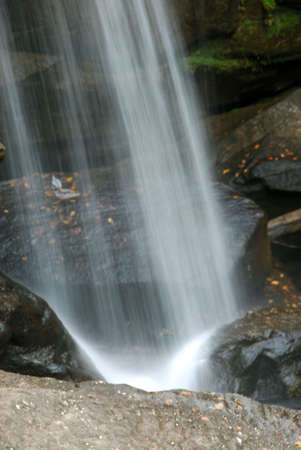 The water falling on the boulders at the bottom of Eagle Falls.  Daniel Boone National Park, Kentucky, USA. Stock Photo - 598902