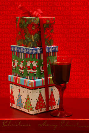 merlot: Holiday Gifts - Festive gift boxes and a glass of merlot wine against a cheerful holiday background.