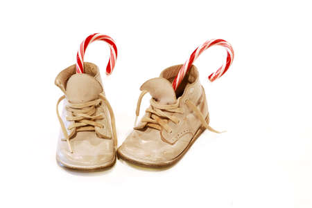 st  nick:  Shoes and Candy Canes - A pair of antique  shoes with candy canes in them.  In the 1950s children would put their shoes by the front door and St Nick would put candy in them if they were good all year.