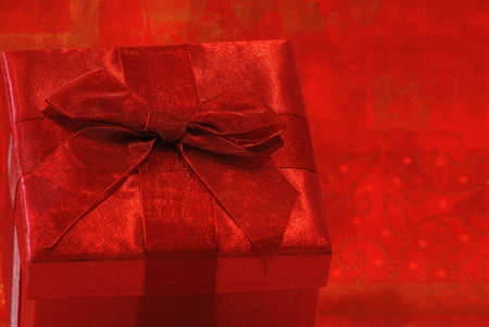 gossamer: Holiday Gift - Pretty red gift in a fabric covered box with red gossamer ribbon and bow for a special person.