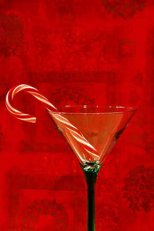 Christmas Cheer- A candy cane in a pretty cocktail glass, ready to pour a drink and toast the holidays. Stock Photo - 671030