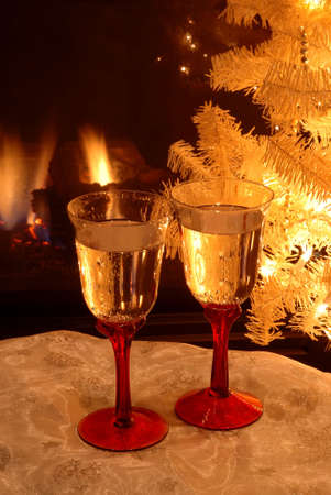 lighted: Toasting the New Year - Two glasses of champagne for toasting the new year in front of the lighted Christmas tree.