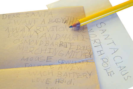 30 year old: Dear Santa Letter with path - A 30 year old letter to Santa Claus, written in 1976 by a six year old child, and the fat pencil she used to write it. Includes clipping path.   Stock Photo