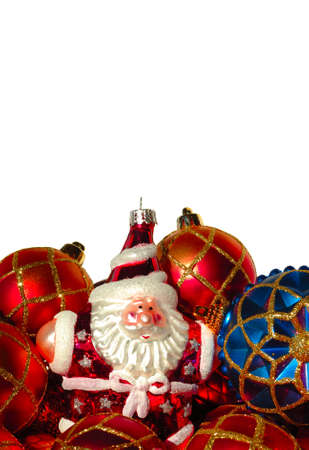 Christmas tree ornaments and Santa in a pile, macro shot on white. photo