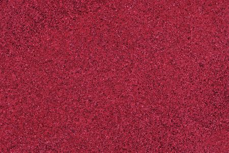 Red Sandstone Texture - a wall paint in red that has sand and other objects in it to give it texture. Stock Photo