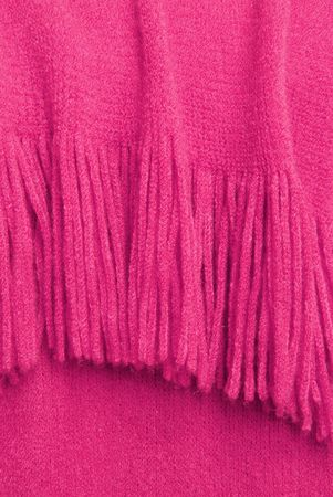flamme: Rose Colored Yarn Fringe - a few strands of deep pink yarn twisted together to make an interesting texture of fringe at the edge of a blanket.