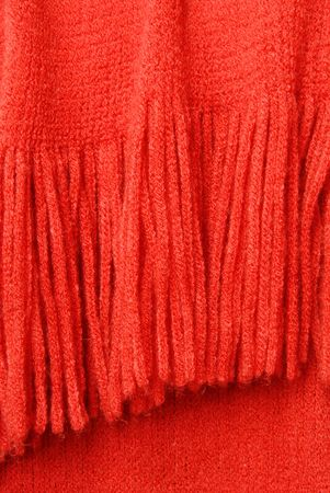 acrylic yarn: Yarn Fringe Blanket - a few strands of red yarn twisted together to make an interesting texture of fringe at the end of an afghan.