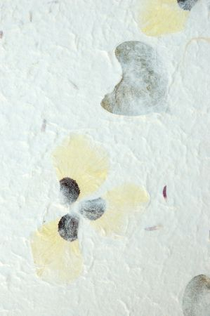 inclusions: Handmade white paper with flower inclusions, for use as an overlay or textured background. Stock Photo