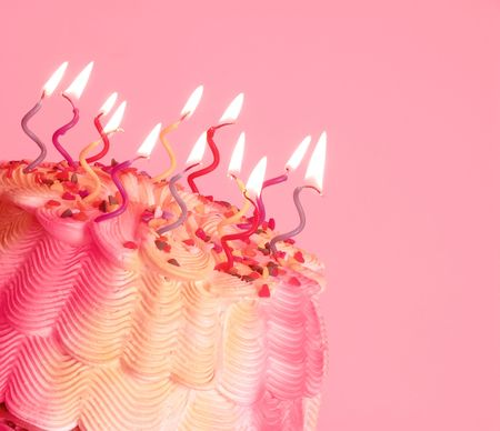 textspace: Birthday Cake - A birthday cake with swirly lighted candles on top.