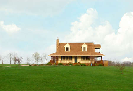 acres: Typical rural farmhouse in the country, sitting alone on acres of land.   Stock Photo