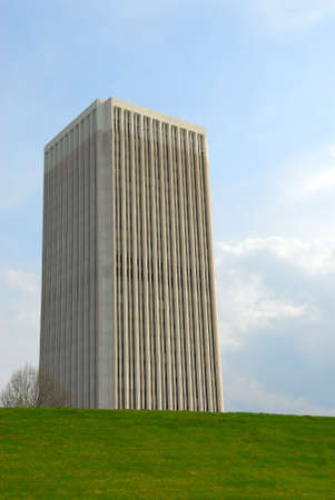 grassy knoll: Tallest Building in Frankfort Kentucky, on the opposite side of a grassy knoll.   Stock Photo