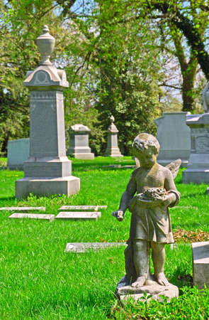 Memorial grave markers at historic Spring Grove Cemetery in Cincinnati Ohio USA.  Spring Grove is the second largest cemetery in the United States and was established in 1845. photo