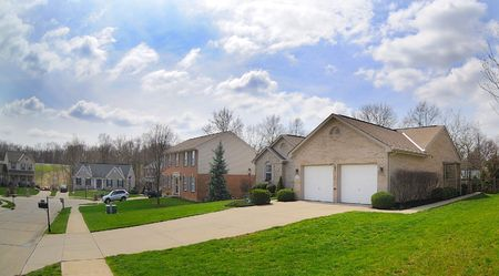 Suburban Neighborhood Brick Homes - a spring day in the burbs. Stock Photo