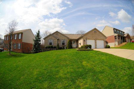 Suburban Neighborhood Brick Homes - a spring day in the burbs. Stock Photo - 4541212