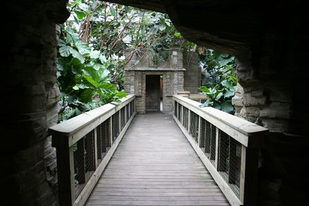 A bridge in a zoo that brings you through an attraction. photo