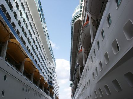 two cruise ships docked across from one another Stock Photo