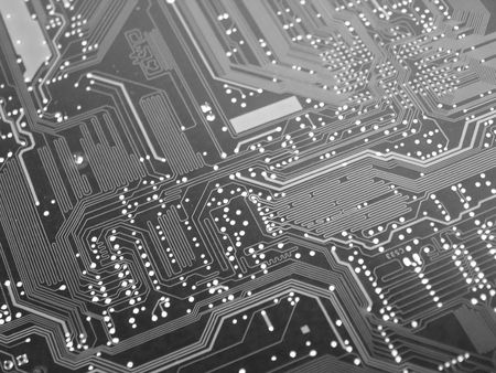 A shot of the back side of a new dual processor computer mother board. This image was used to create a background and a logo for a computer companys website. This image is also a nice background image for print material related to computer technology.