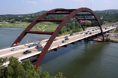A shot of the Austin 360 Bridge on a clear calm day.  This is a very pretty picture of the bridge and a great symbol of Austin, Texas. Stock Photo