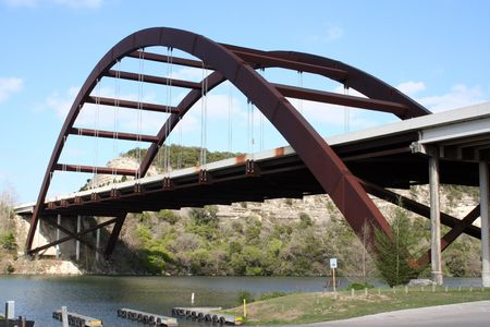 capital of colorado: A shot of the Austin 360 Bridge on a clear calm day.  This is a very pretty picture of the bridge and a great symbol of Austin, Texas. Stock Photo