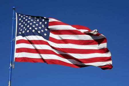 An American flag flaping boldly in the wind. Stock Photo - 527157