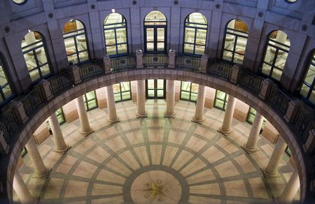 A nice clean shot of the Texas State Capitol Building in downtown Austin, Texas at night.  This is the underground extension as seen from the ground level. Stock Photo - 536426