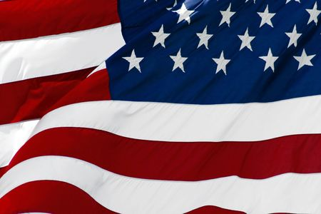 An American flag flaping boldly in the wind. Stock Photo - 601324