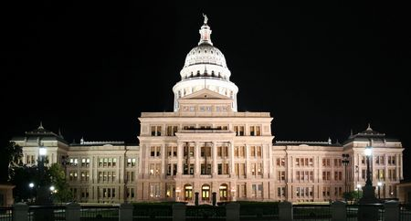 A nice clean shot of the Texas State Capitol Building in downtown Austin, Texas at night. photo