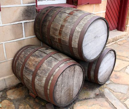 casks: Old wooden barrels on the sidewalk.