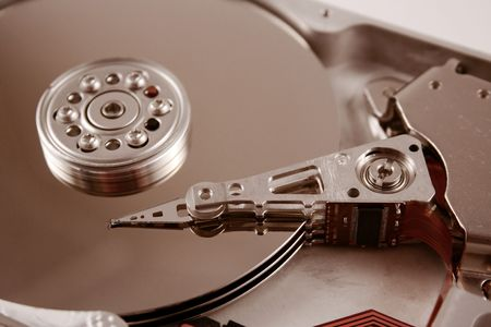 harddrive: A close up macro of an opened computer harddrive.
