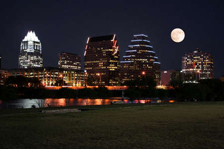 A very pretty night in Austin, Texas.  This shot was taken from across Town Lake downtown.  A very useful image for Austin related content.  The moon was adding in for effect. Stock Photo
