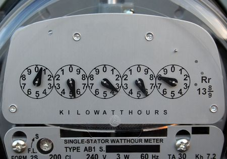 electric meter: Un close-up de un medidor de luz.