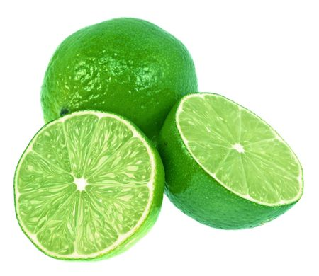 two and a half: Two green limes. One is cut in half.  Very green and isolated on white.