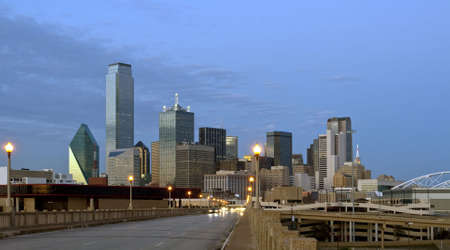 Downtown Dallas Texas at night just after sunset.  Traffic is coming at the camera and creates a nice blur. Stock Photo
