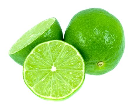 two and a half: Two very green limes isolated on a white background.  One is cut in half.