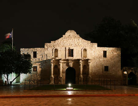 the Alamo lit up at night in San Antonio Texas Stock Photo