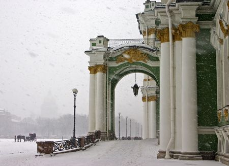 Snow-fall in Saint-Petersburg on a palace area in Christmas photo