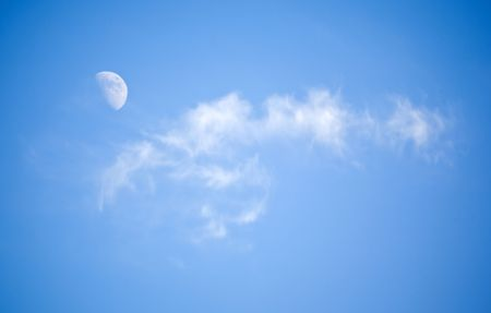 winter day: The moon and lonely cloud in clear winter day Stock Photo