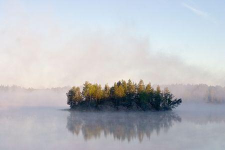 Fog at a dawn on lake in Kareliya photo