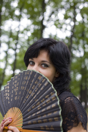 portrait of a young dark-haired woman with a China fan photo