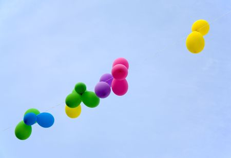 multicolored balloons on the string across the blue sky Stock Photo - 1805640