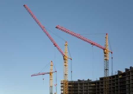 Building cranes on a background of the sky photo