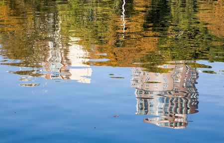 reflaction: river reflaction of the city buildings over the trees Stock Photo