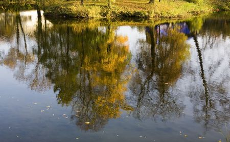 ceasing: reflection of the autumn park in the lake Stock Photo